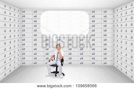 Businessman Sitting In Security Safe Room