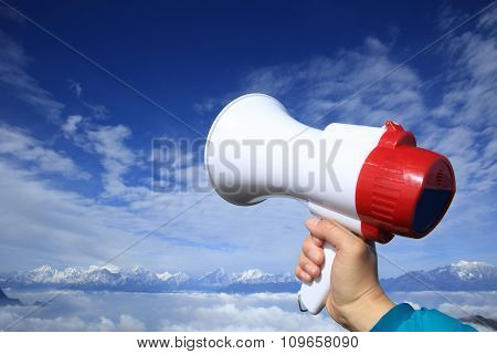 hands hold loudspeaker