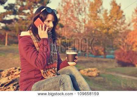 Girl Holding Cup Of Coffee And Phone
