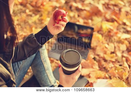 Hipster Girl With Coffee Cup And Apple