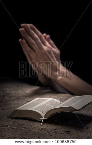 Christian lady with book prays for goodness