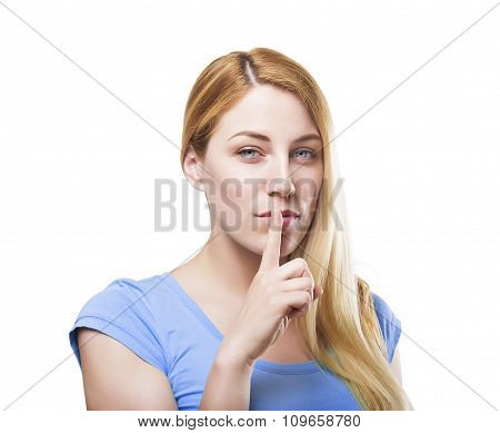 Blonde holding a finger to her mouth.