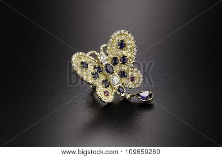 Butterfly yellow gold diamond ring with sapphires and rubies