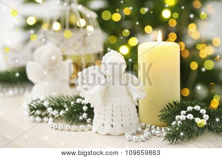 Christmas decorations with candles on fir tree background