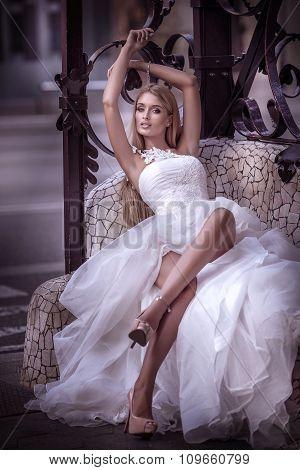Blonde Bride Woman In Wedding Dress.