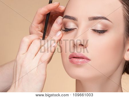 Experienced beautician is working at beauty salon