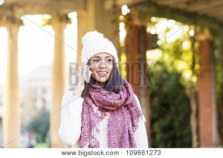 Happiness Woman With Cap And Scarf Talking By Phone, Outdoor.