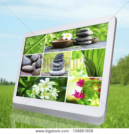 Tablet PC with images of natural objects,  on light nature background