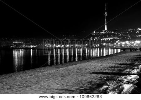 Baku Bulvar with snow at night, looking towards the Telecoms Tower, in the capital of Azerbaijan