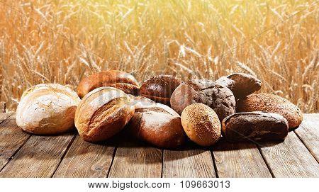 Fredh bread on field background