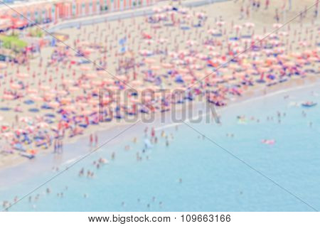 Defocused Background With A Crowded Beach In  Italy
