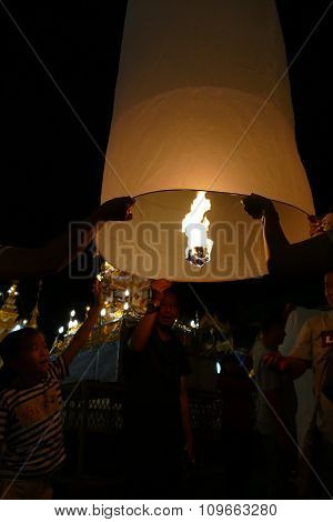 People With Thailand Traditional Paper Lantern At Night