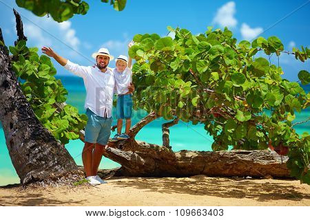 Smiling Father And Son On Summer Vacation Near The Tropical Seaside