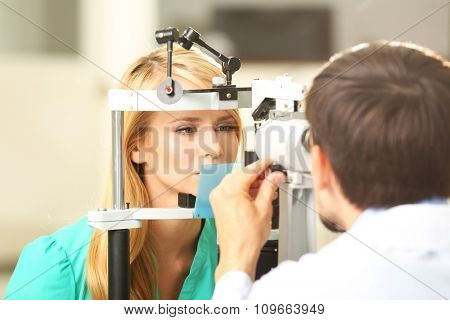 Adult male doctor examing adult female patient
