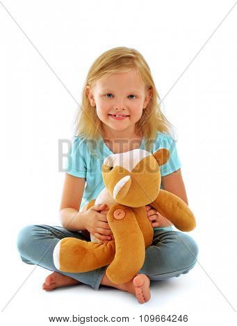 Beautiful little girl with teddy bear, isolated on white