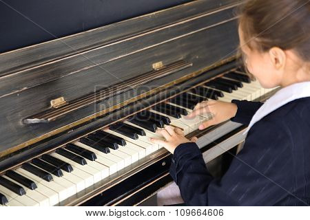 Close up of little girl hands piano playing