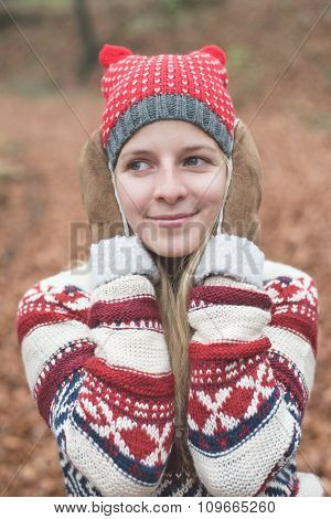young long hair woman posing outdoor in warm clothes during travel
