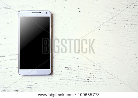 Phone on wooden background
