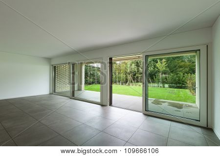 interior of new apartment, empty hall with window, tiled floor