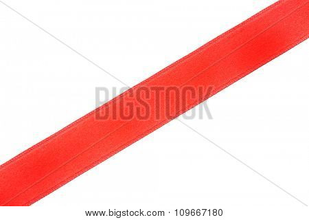 one red diagonal ribbon, isolated on white