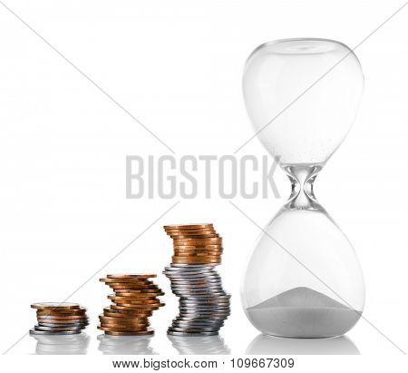 Hourglass with coins isolated on white