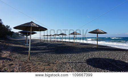 Natural Black Lava Beach Koulombos On Santorini Island