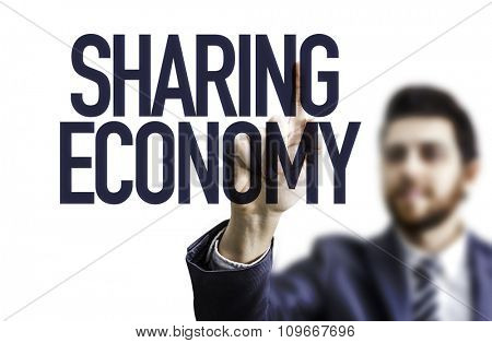 Business man pointing the text: Sharing Economy