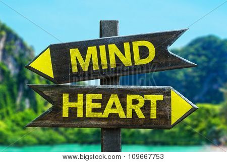 Mind - Heart signpost in a beach background