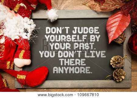 Blackboard with the text: Don't Judge Yourself By Your Past. You Don't Live There Anymore.
