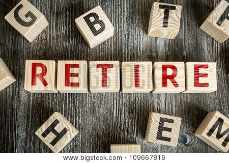 Wooden Blocks with the text: Retire