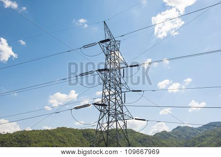 High voltage post ,High voltage tower with blue sky background.