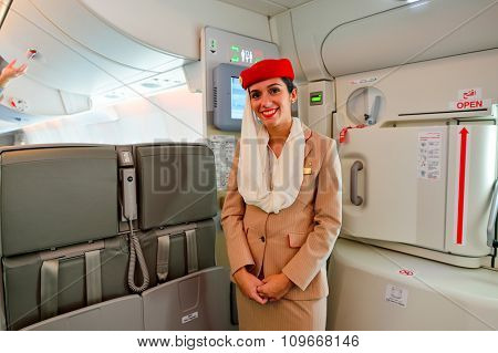 HONG KONG - NOVEMBER 22, 2015: Emirates crew member on board of Airbus A380. Emirates is an airline based in Dubai, United Arab Emirates. It is the largest airline in the Middle East.