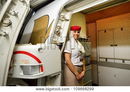 HONG KONG - NOVEMBER 16, 2015: Emirates crew member on board of Boeing 777. Emirates is an airline based in Dubai, United Arab Emirates. It is the largest airline in the Middle East.