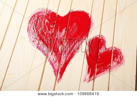 Hearts painted on wooden wall