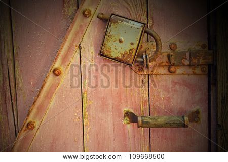 Brown wooden locked door background, close up