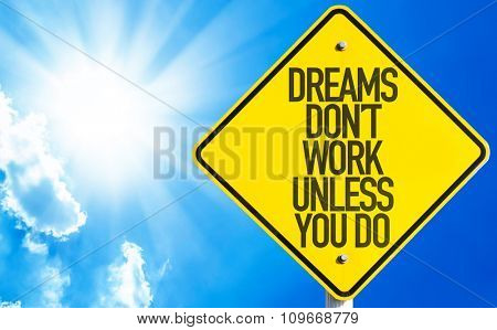 Dreams Don't Work Unless You Do sign with sky background
