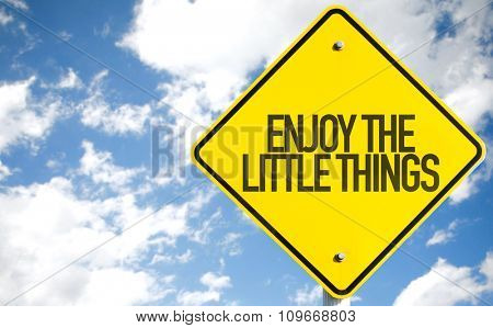 Enjoy the Little Things sign with sky background