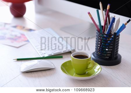 Green cup of coffee on modern table