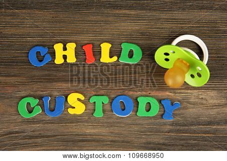 A dummy and colourful letters regarding child-custody and family-law concept