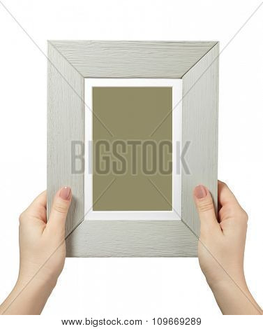 female hand holding a wooden frame isolated on white background. close up