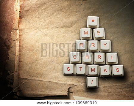 Christmas card - Christmas tree made of computer keys, Old paper background