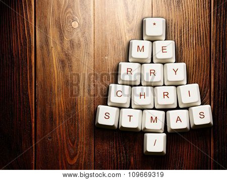 Christmas card - Christmas tree made of computer keys,tree background with vignette