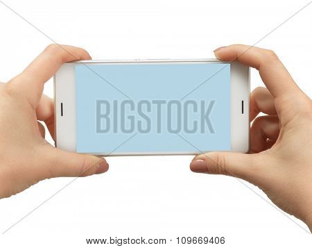 Woman hand holding the white smartphone. Isolated on white background