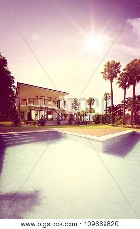 Retro Colored Image of Upscale Home - View of Luxury House from Back Yard with Swimming Pool and Surrounded by Palm Trees Under Bright Sun. 3d Rendering