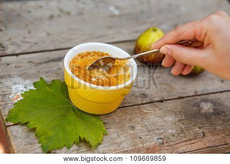 French dessert creme brulee in porcelain bowl on wooden boards