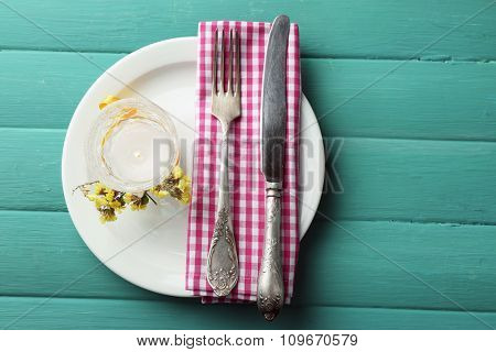 Summer table setting  on color wooden background