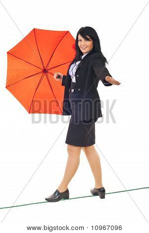 Executive Walk On Tightrope With Umbrella