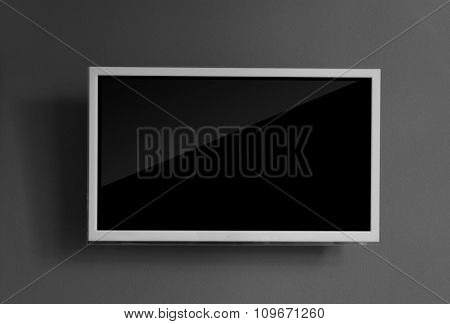 Wide screen television on grey wall background