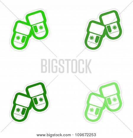 Set of paper stickers on white background mittens snowflakes