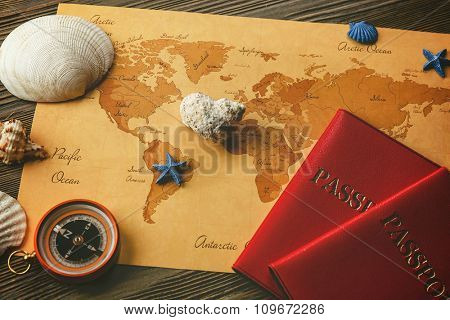 Beautiful composition with sea accessories and passports on table close up